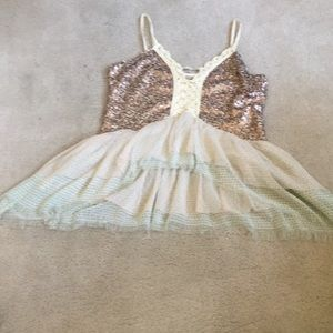 Gimmicks sequence, lace top.